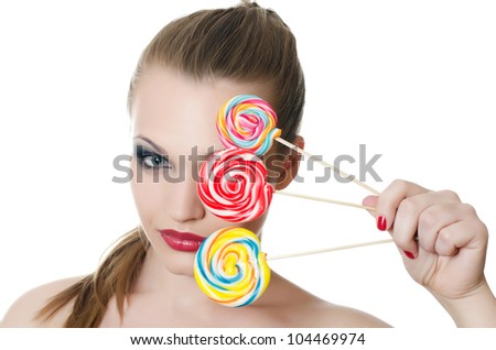The girl with a sugar candy isolated
