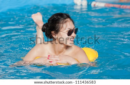 the girl with a swimming cylinder