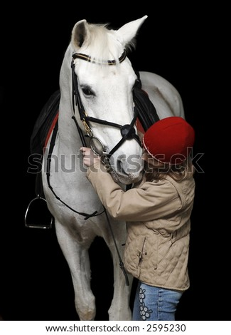 The girl with a white horse on a black background...