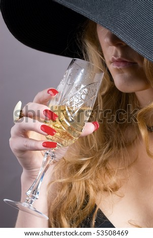 The girl with blonde hair in a hat with glass fault - stock photo