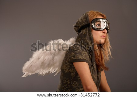The girl with glasses and with wings on his back