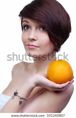 The girl with orange on a white background