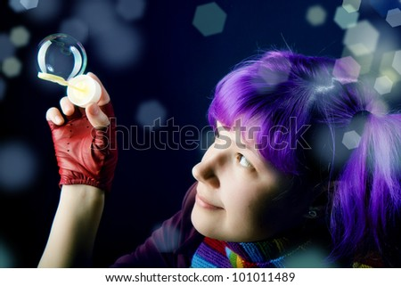 the girl with purple hair, playing with soap bubbles