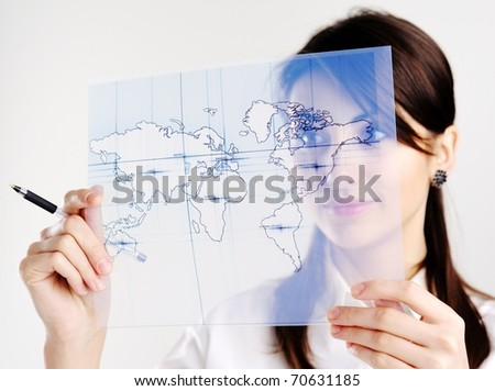 The girl with the map of the world printed on a transparent material