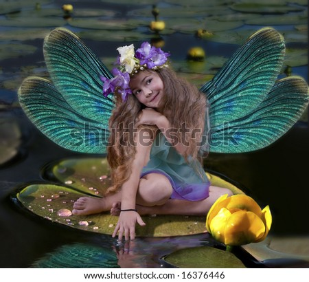 The girl with wings sits on a leaf in water