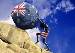 The girl, wrapped in the flag of the United States of America, raises a stone to the top in the form of the silhouette of the flag of Australia
