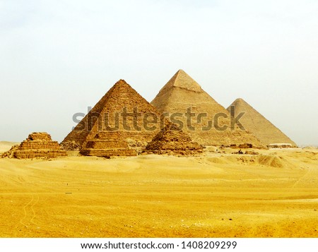 TheGiza pyramid complex in Giza in Egypt, built as the tomb for Egyptian pharaohand consort during theOldandMiddle Kingdomperiods.  #1408209299