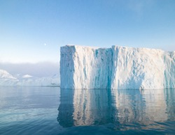 The glaciers are melting on arctic ocean in Greenland. Big glaciers day by day broking and dangerous for world climate system. Shooting day was foggy weather and glaciers didn't look clear.