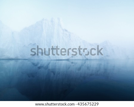 The glaciers are melting on arctic ocean in Greenland. Big glaciers day by day broking and dangerous for world climate system. Shooting day was foggy weather and glaciers didn't look clear. #435675229