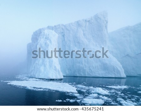 The glaciers are melting on arctic ocean in Greenland. Big glaciers day by day broking and dangerous for world climate system. Shooting day was foggy weather and glaciers didn't look clear. #435675241