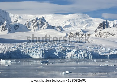 The glaciers on the coast of the western Antarctic Peninsula a sunny summer afternoon.