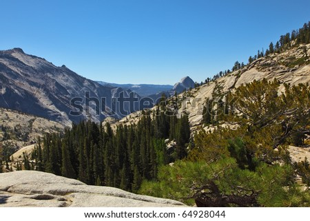 The glade shined by the sun at top of mountain. A magnificent mountain panorama national park Yosemite