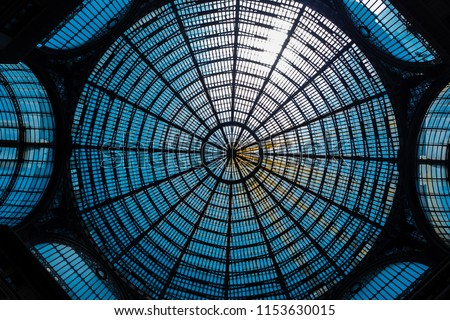 The glass and metal dome of a shopping gallery in Naples, Italy.