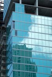 The glass covered modern skyscraper under contruction in Miami downtown (Florida).