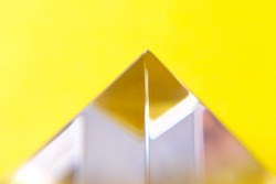 The glass pyramid on a yellow background blurred yellow background