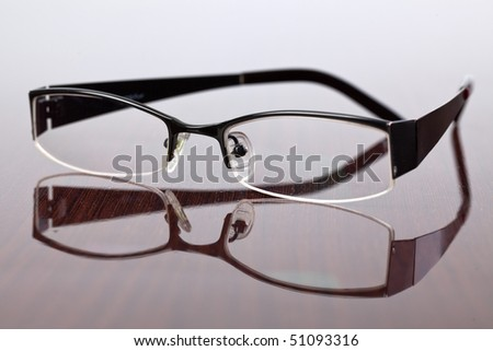 the glasses on wooden table