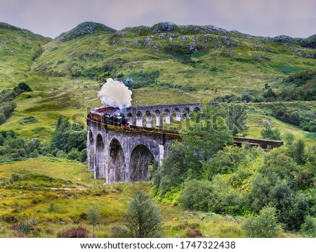 The Glenfinnan Viaduct railway viaduct on the West Highland Line in Glenfinnan Scotland. Located at the top of Loch Shiel the viaduct overlooks the Glenfinnan Monument and the Loch Shiel