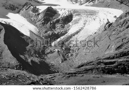 The global climate change is responsable for fast melting glaciers and permafrost like here at Morteratsch glacier in the upper Engadin #1562428786
