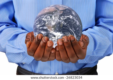 The globe in hands. Earth picture courtesy of Nasa.