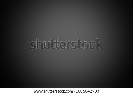 The glossy black background is blurred. Used for surface finishing. gradient image is abstract blurred backdrop. Ecological ideas for your graphic design, banner, or poster.