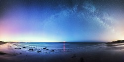 The glow from the Northern Lights and the Milky WAy over Coquet Lighthouse in Northumbria