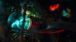 The glow of light bulbs.Vintage, luxury lamp glow on the Xmas tree. Festive mood. Garland or glass lantern, decoration.Xmas decor.Holiday,Decorative string lights.Closeup.