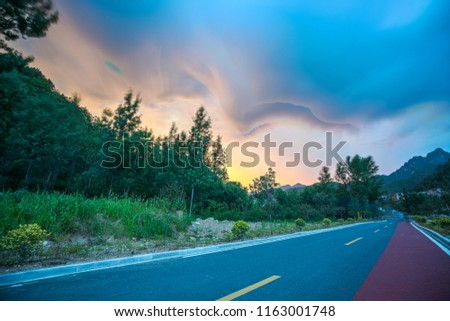The glow of the evening glows under the roads of the countryside #1163001748