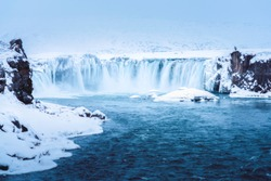 The Godafoss or water of Gods is a big waterfall located in Northeastern Region in Iceland,Europe. There is a Photographer standing with his camera.