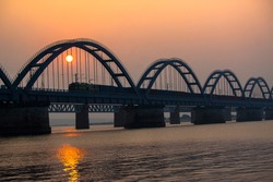 The Godavari Arch Bridge is a bowstring-girder bridge that spans the Godavari River in Rajahmundry, India. It is the latest of the three bridges that span the Godavari river at Rajahmundry.