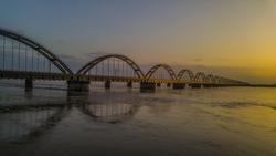 The Godavari Arch Bridge is a bowstring-girder bridge that spans the Godavari river in Rajahmundry, India. It is the latest of the three bridges that span the Godavari river at Rajahmundry