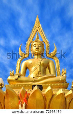The gold buddha statue is on the sky background