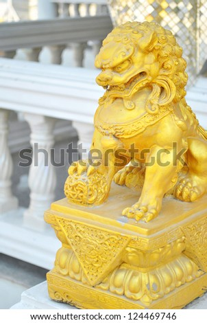 The gold chinese lion is stand on the stand - stock photo