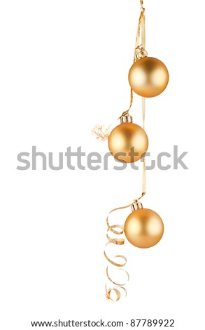 The golden balls on a white background .
