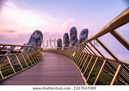 """The Golden Bridge at Bana Hills,Da Nang,Vietnam, known as """"Hands of God"""", a pedestrian footpath lifted by two giant hands"""