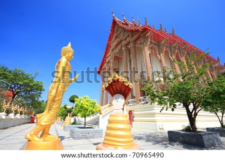 The Golden Buddha Image In Front Of The Ancient Temple In Thailand