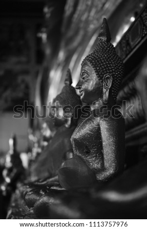 The golden Buddha image. Reverence in Buddhist sutras At Wat Luang Pothit, Thailand #1113757976
