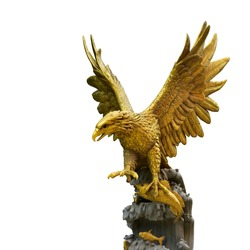 The golden eagle statue spreads its wings to catch fish on the rock. isolated on white background. This has clipping path.