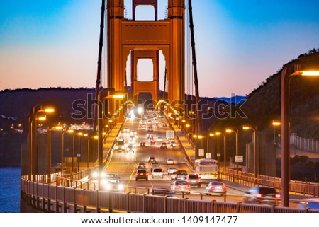 The Golden Gate Bridge is a suspension bridge spanning the Golden Gate, the one-mile-wide strait, connecting San Francisco and Marin County, carrying  U.S. Route 101 #1409147477