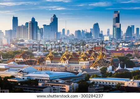 The Golden Grand Palace of Bangkok. with skyscraper view of cityscape at sunrise time. The most favorite landmark of travel destination of asia. Best of amazing beautiful scene of Thailand.  #300284237
