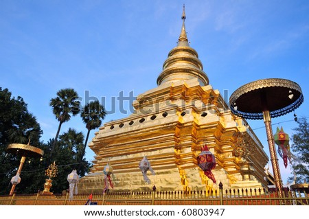 The Golden Pagoda in the evening. The Jomthong Pagoda in Wat (Temple) Phrathat Sri Jomthong, Chiang Mai Province, Thailand. This relic pagoda, kept the Buddhaâ??s right-side skull.