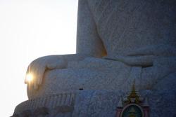 The golden ring sparkling on buddha finger