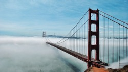 The Golden State Bridge covered by Fog