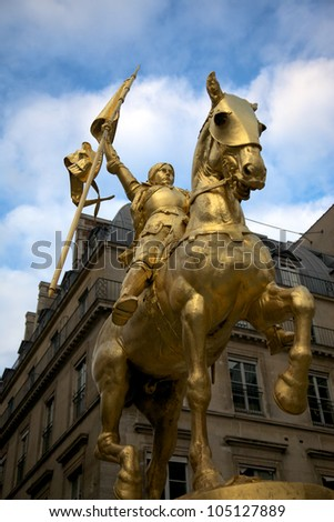 The golden statue of Saint Joan of Arc in Paris, France.
