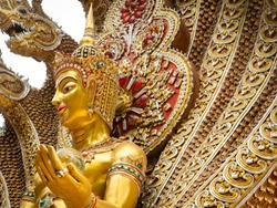 The Golden Statue of The Angel in The Nine Headed Serpent in The Temple