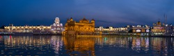 The Golden Temple at Amritsar, Punjab, India, the most sacred icon and worship place of Sikh religion. Illuminated in the night, reflected on lake.