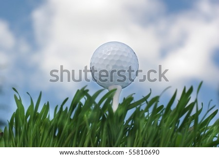 the golf ball on background of sky from clouds