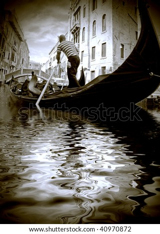 The gondolier floats on the channel of Venice