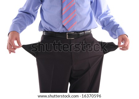 stock photo : The gone bankrupt businessman stands with the turned out pockets
