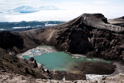 The Gorely Volcano. The crater of the Gorely volcano. Lake in the crater of Gorely volcano. Kamchatka. July 2020.