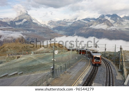 The Gornergratbahn, a narrow gauge mountain rack railway, approaching the Gornergrat summit station. Matterhorn in the background.